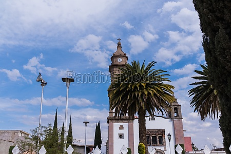 old mexican church and palm trees