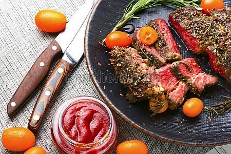 succulent veal steak with kumquat