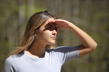 woman protecting from sun looking away