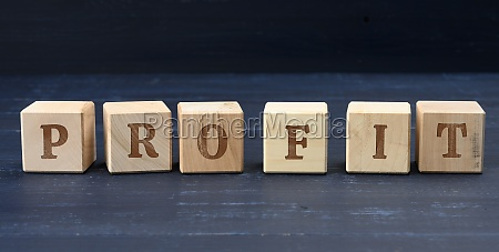 wooden cubes with the inscription profit