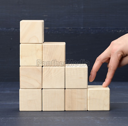 a stack of wooden cubes 6