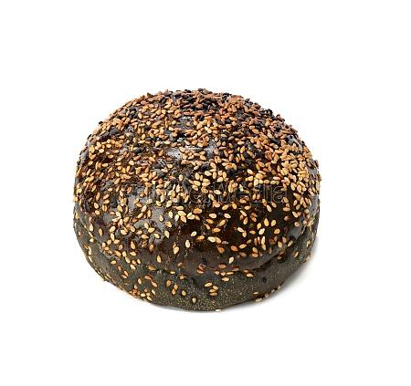 black baked bun with sesame seeds