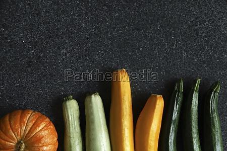 an arrangement of pumpkin and courgette