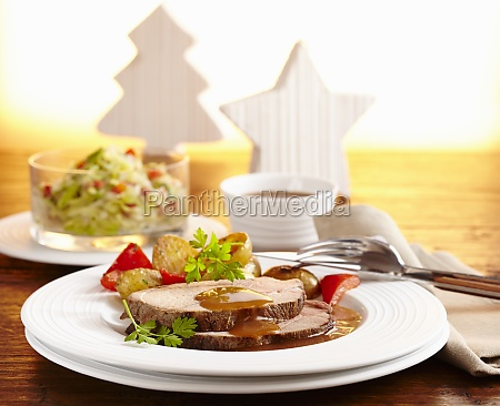 roast wild boar with coleslaw and
