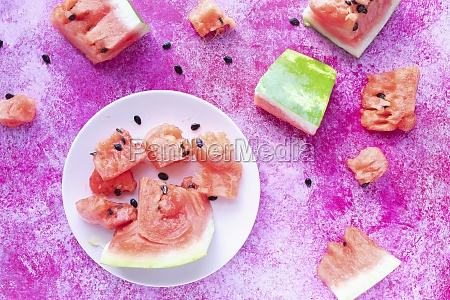 watermelon slices on a white plate