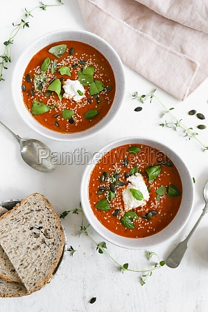 two bowls of roasted tomato soup