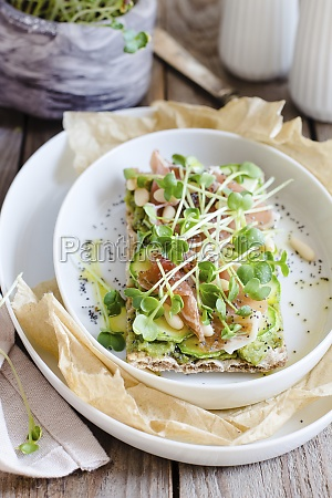 open sandwich with microgreens and ham