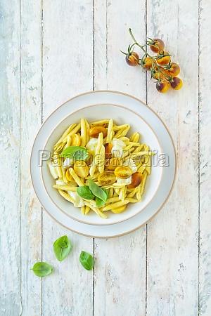 macaroni with yellow tomatoes mozzarella and
