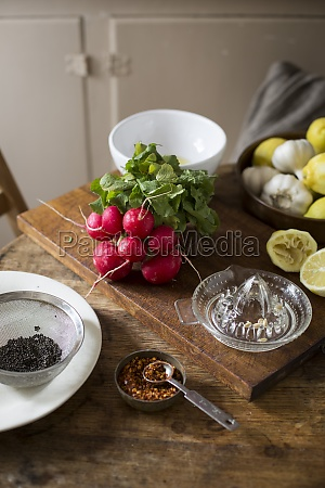 radishes lemons garlic and spices in