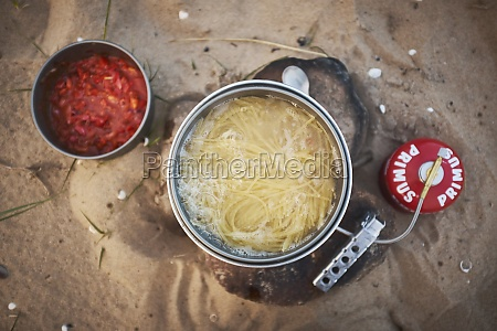 noodles being cooked on a gas