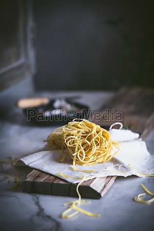 appetizing dry pasta on tablecloth on