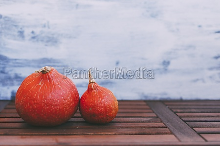 orange ripe vegetables on wood planks