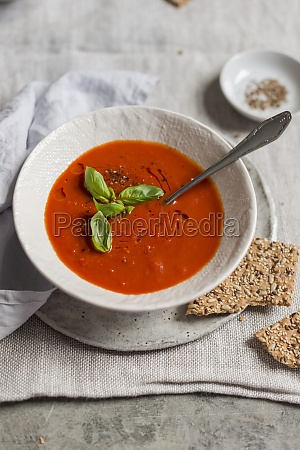 tomato soup with fresh basil in