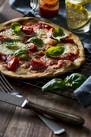 pizza margherita with fresh cherry tomatoes