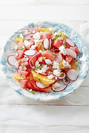 watermelon salad with orange radish and