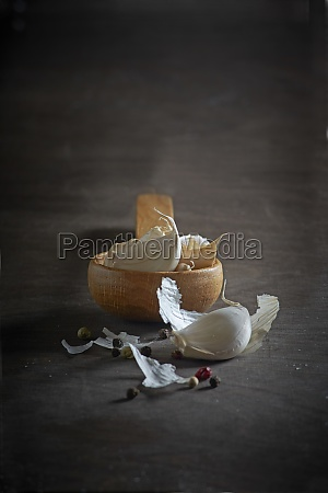garlic cloves with a wooden spoon