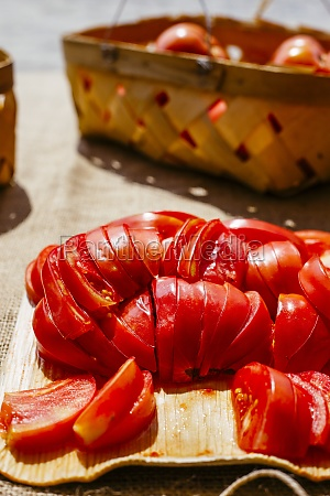 sliced juicy red tomatoes in afternoon