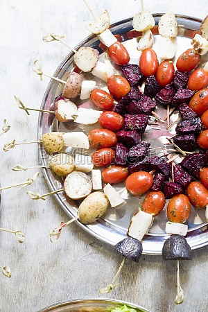 colorful vegetable skewers or kabobs on