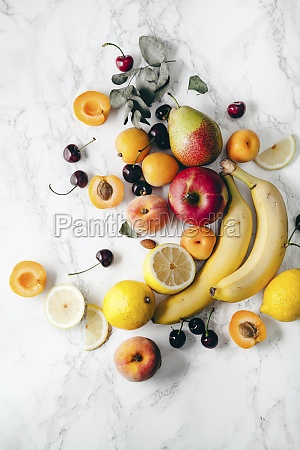 summer fruits assorted on white marble