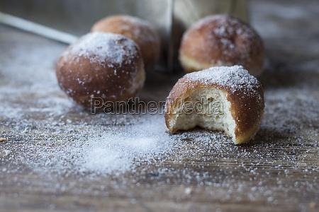fresh beignets near set of baked
