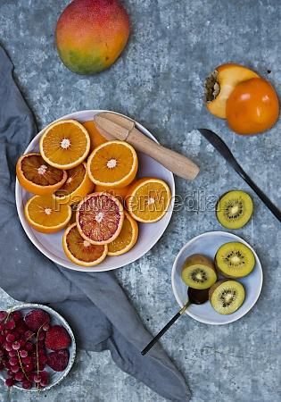 fresh fruits blood oranges mango persimmons