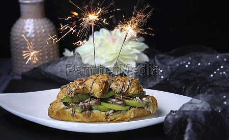 a croissant with kiwi and chocolate