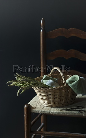 beautiful basket with wild asparagus on