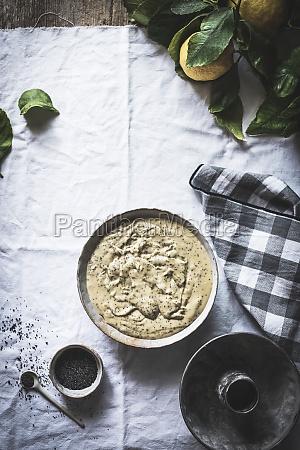 gravy in dish near cup ofpoppy