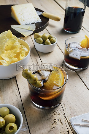 served cocktails and snacks on table
