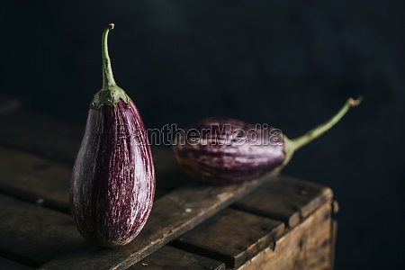 graffiti eggplant on wooden table and