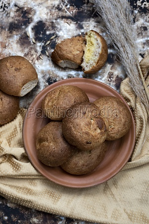 fresh buns placed on brown plate