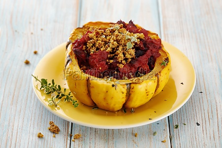 a pumpkin filled with beetroot cashew