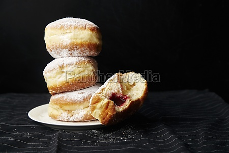 a stack of donuts with jelly