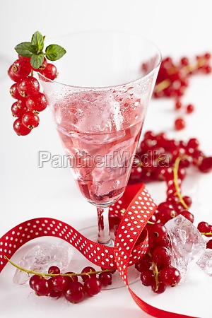 homemade redcurrant liqueur with a ribbon