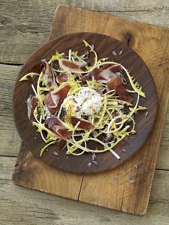 dandelion salad with iberico ham and