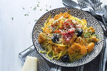 pumpkin spaghetti with pumpkin ragout tomatoes