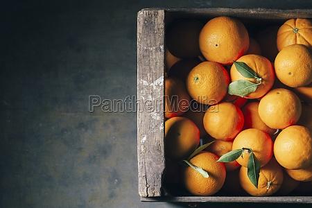 fresh oranges in an old wooden