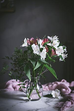jar of flower on table