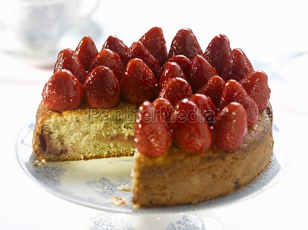 sponge cake topped with whole strawberries