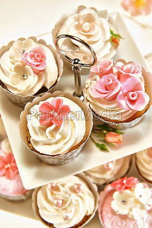 festive cupcakes decorated with cream topping