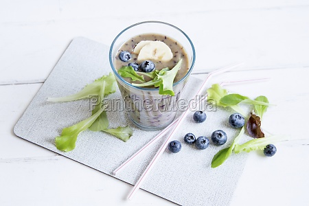 a blueberry smoothie with mixed leaves