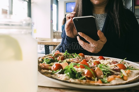 female using mobile phone and sitting
