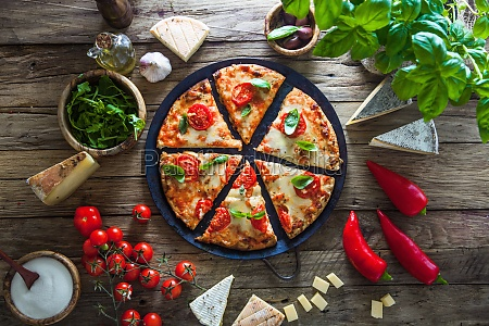 pizza with cheese tomatoes and basil