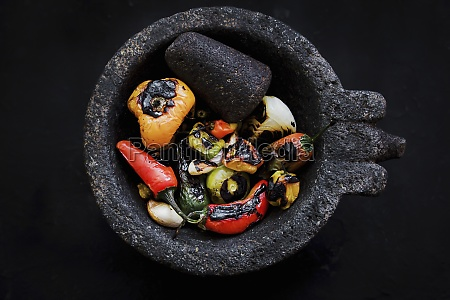 roasted vegetables placed on black tray