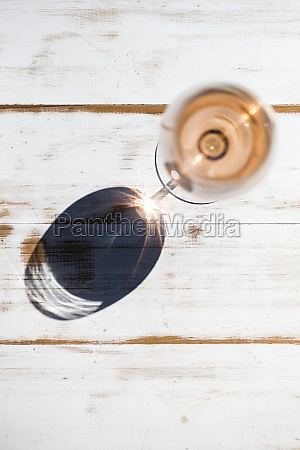 a glass of rose wine with