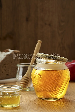 jar of honey with honeycomb in