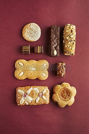 various gingerbread biscuits on red paper