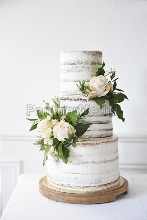a naked three tier wedding cake