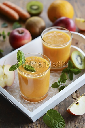 two glasses of fruit juice on