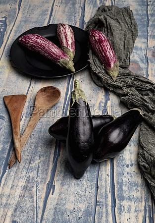 set of fresh ripe eggplants placed